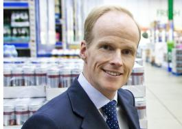 Tesco Booker merger Charles Wilson chief executive